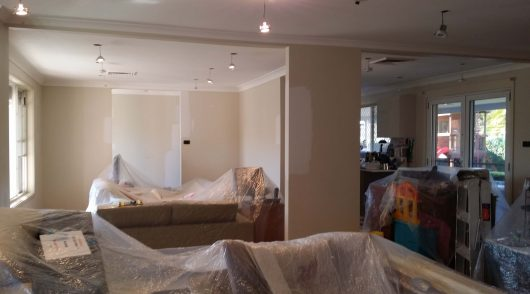 Covering of furniture to prevent paint drips